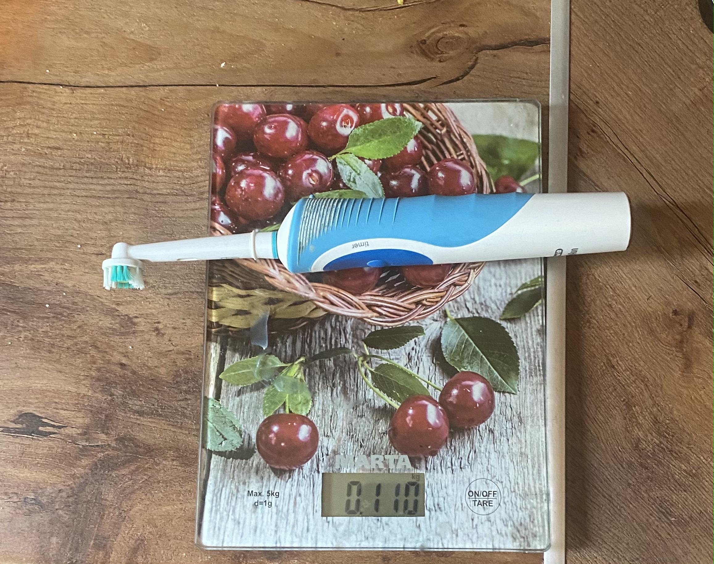 вес электрической зубной щетки